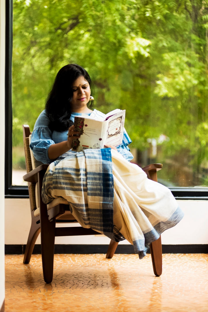 Falguni Patel, Appleblossom, top 100 Indian fashion blogs, fashion blogger in gujarat, ahmedabad blogger, saree blogger, saree pact, kutch kala cotton, Three threads, Ministry of utmost happiness, bibliophile, girl reading a book, susegad, slow life, old world charm , silver jewellery